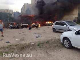 Луганск в огне: пылают дома и машины, над городом клубы дыма, на улицах погибшие (фото/видео 18+)